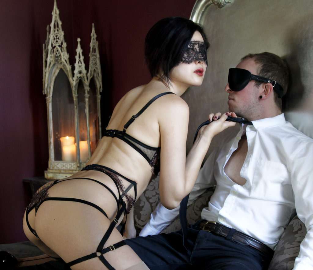 Femdom Domina Yuki teases her blindfolded male submissive. Domina Yuki specializes in bondage and total power exchange.