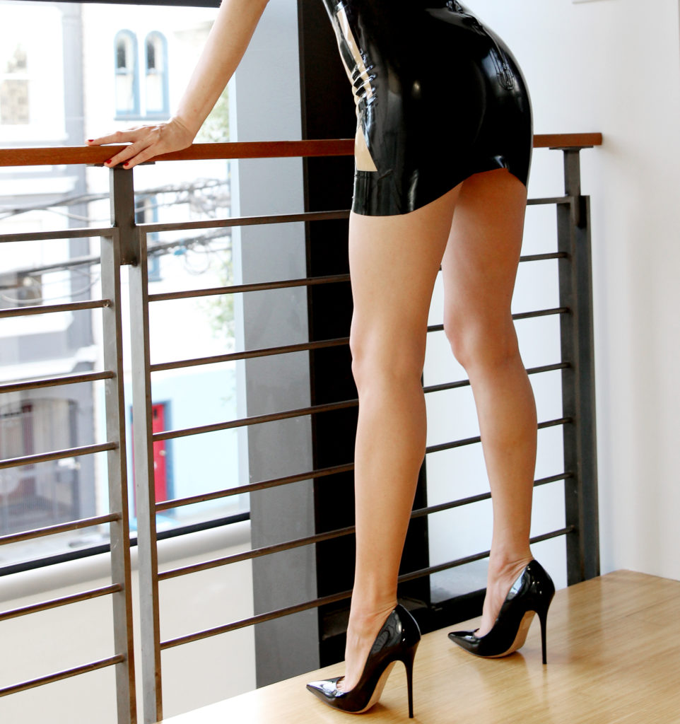 Asian Dominatrix based in San Francisco in a latex dress and stiletto Louboutins. She enjoys bondage, CFNM, and fetish.