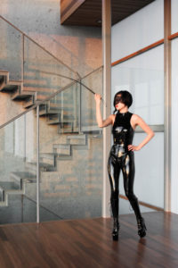 San Francisco Asian Dominatrix Yuki cracks her leather whip as she wears a latex body suit and leather boots.