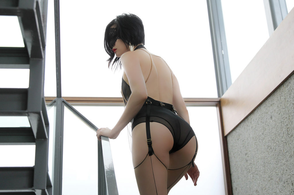 Bay Area Asian Dominatrix Domina Yuki in stockings and lingerie. She provides bespoke BDSM, fetish, and fantasy experiences