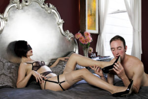 Asian prodomme Domina Yuki allows her slave to worship her while wearing lingerie and stiletto Louboutins.