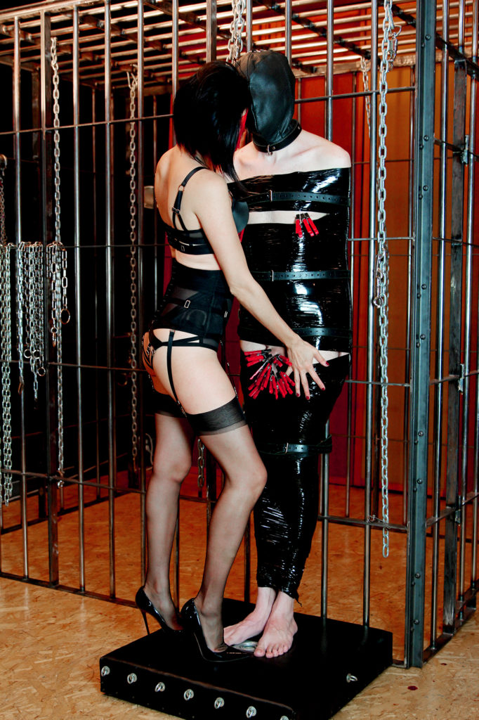 Asian Dominatrix Domina Yuki teases her bound submissive while playing with sensory deprivation and CBT.
